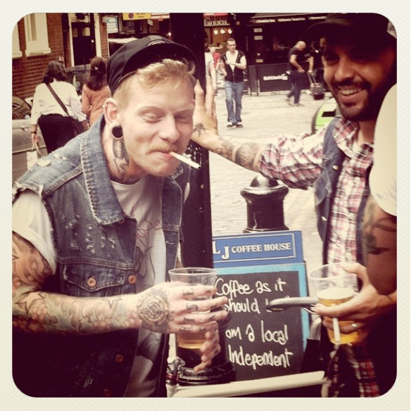 Tattoed guy with pint